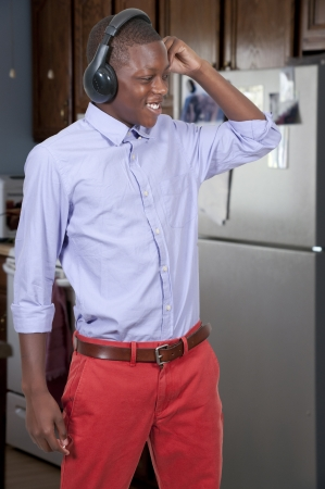 Young black African American teenage boy listening to headphones photo