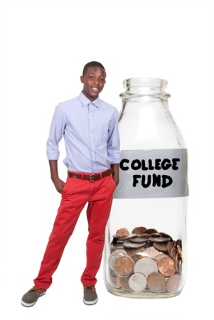 american currency: Handsome boy holding her college fund of coins in a milk bottle
