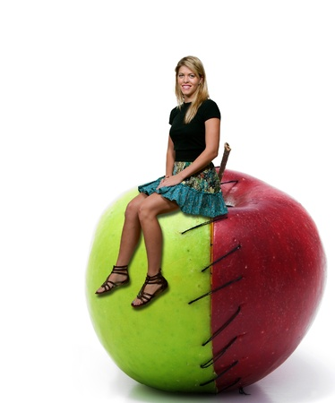 winesap apple: Beautiful woman sitting on a whole red and green apple