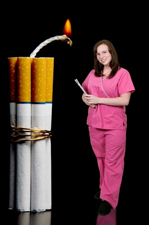 Doctor or nurse with several cigarettes bound together like sticks of dynamite photo