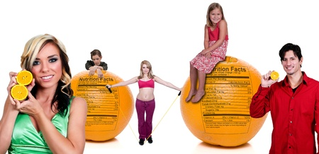 Variety of people standing around oranges with a nutrition labels photo