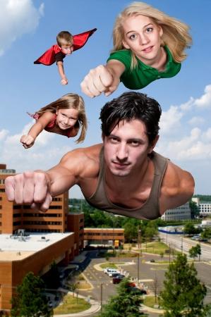 Family of super heros flying through the sky Stok Fotoğraf