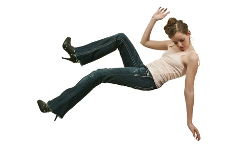 teenaged girl: A beautiful young teenage woman falling through the sky Stock Photo