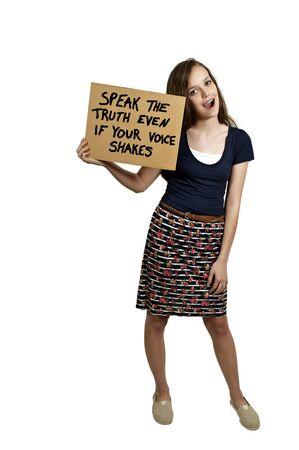 teenaged: A beautiful young teenaged woman holding up a sign Stock Photo