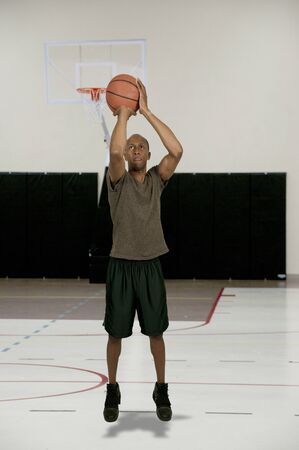 Handsome black African American man playing basketball Stock Photo - 15646761