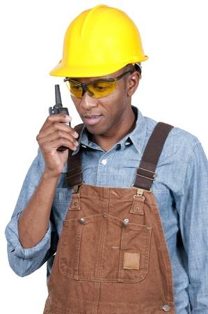 walkie talkie: Handsome black man construction worker talking on a walkie talkie Stock Photo