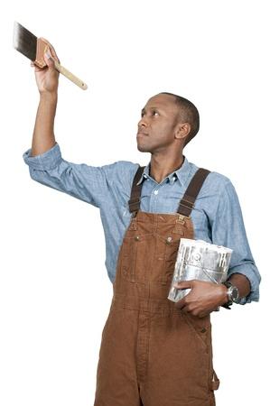 pintor: Hombre guapo pintor de corte con un pincel