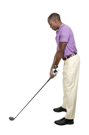 Handsome man playing a round of the sport known as golf Stock Photo - 15646630