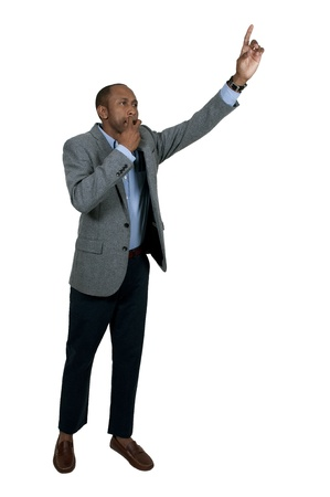 Black businessman hailing a cab in the city photo