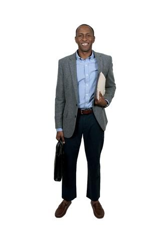 rozradostněný: Hezký černý afro-americké obchodní muž s Manile složky plný dokumentů Reklamní fotografie
