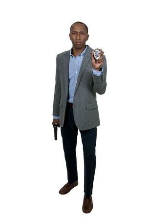 A black African American police detective man on the job with a gun Stock Photo - 15646670