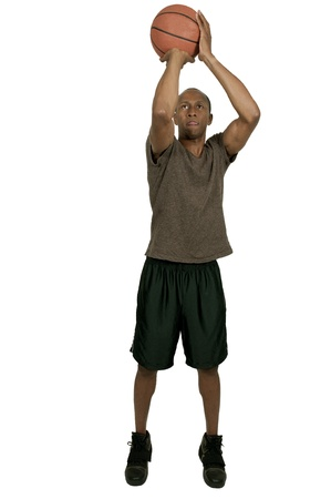 Handsome black African American man playing basketball photo