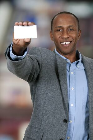 Handsome African American man holding up a business card Stock Photo - 15646842