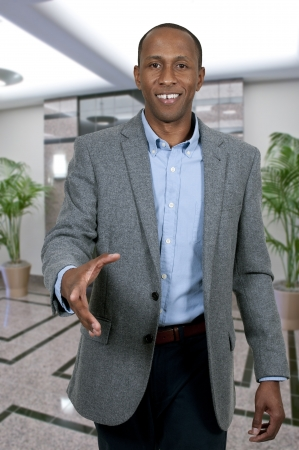 Handsome African American businessman shaking hands photo