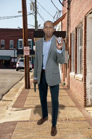 Black African American police detective man on the job with a gun