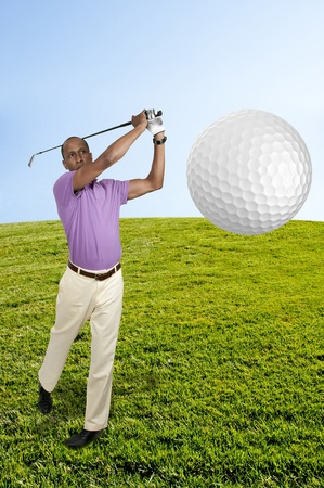 Handsome man playing a round of the sport known as golf photo