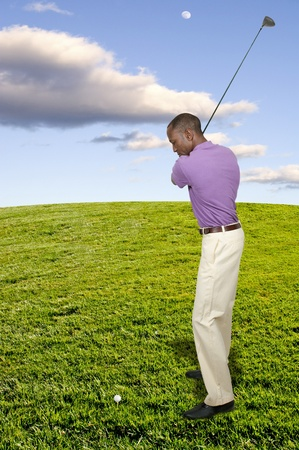 Handsome man playing a round of the sport known as golf Stock Photo - 15646792