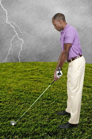 ball lightning: Handsome man playing a round of the sport known as golf Stock Photo