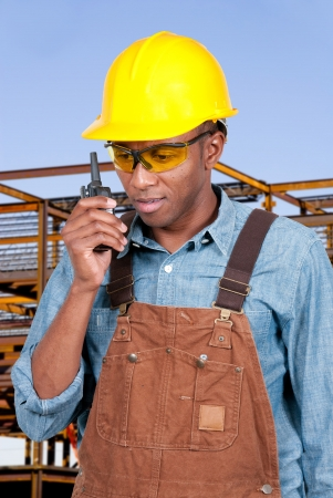 walkie: Handsome black man construction worker talking on a walkie talkie Stock Photo