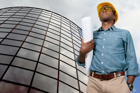 project: Black African American male construction worker a job site.