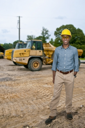 dumps: A black man African American Construction Worker on a job site.
