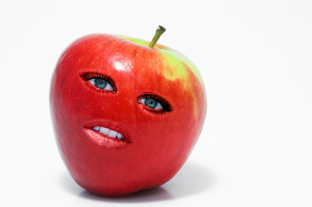 Beautiful whole female red delicious apple with lips and eyes Stock Photo - 15646631