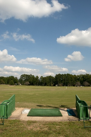 driving range: Grassy driving range beside a golf course