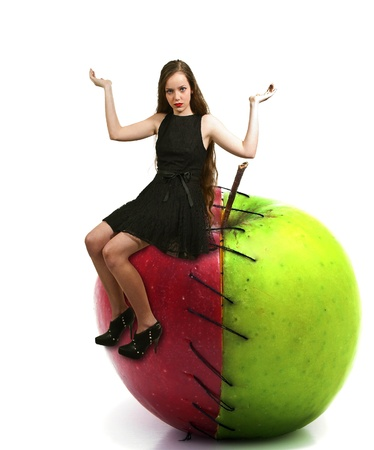 winesap apple: Beautiful teenage woman sitting on a sweet and sour apple