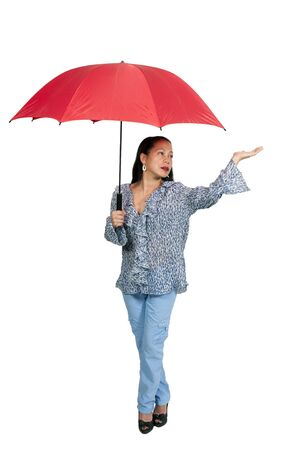mature mexican: A middle aged woman holding an umbrella in the rain