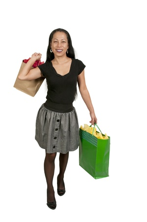A beautiful young Hispanic Latino woman on a shopping spree photo