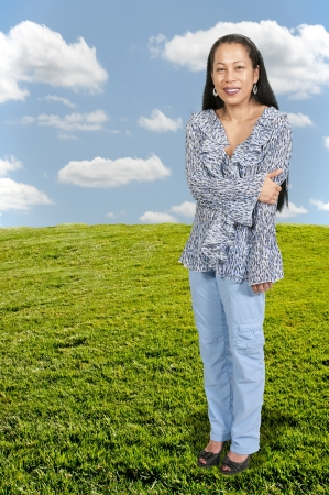 Lovely middle aged hispanic latino woman looking far away photo