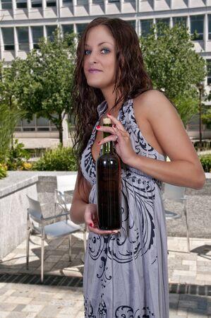 Beautiful woman holding a bottle of wine photo