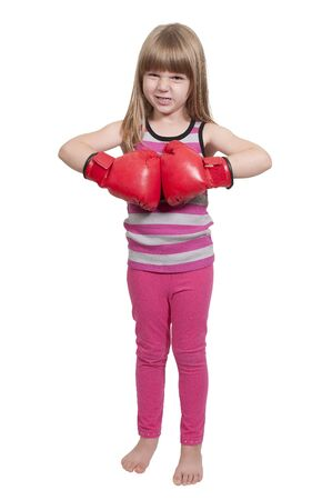 Beautiful young little girl wearing a pair of boxing gloves Stock Photo - 16165533