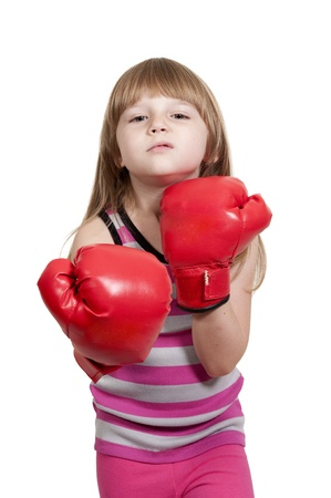 Beautiful young little girl wearing a pair of boxing gloves Stock Photo - 16165498