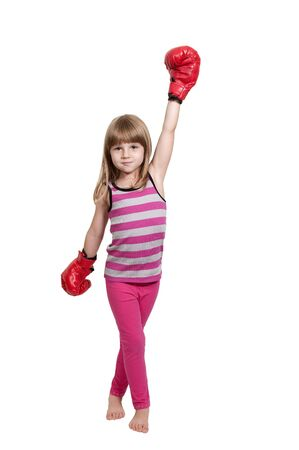 female boxer: Beautiful young little girl wearing a pair of boxing gloves