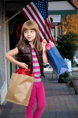 Beautiful litte girl on a shopping spree