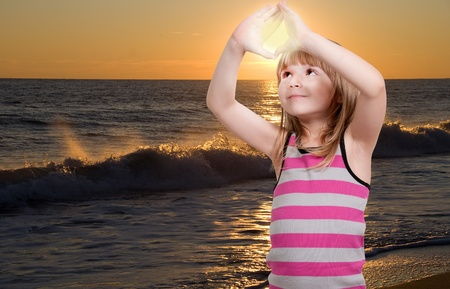 Beautiful young little girl hanging the sunset Stock Photo - 16717595