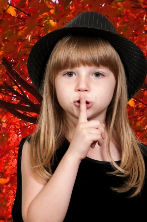 Little girl saying be quiet by saying shhh