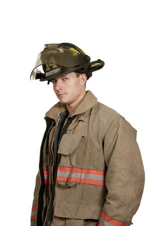 Jonge aantrekkelijke mannelijke Amerikaanse mens brandweerman klaar voor het werk Stockfoto