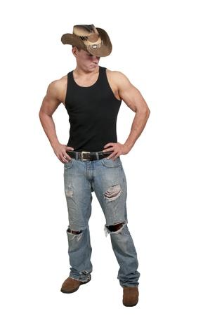 スタイリッシュなカウボーイ ハットを着てハンサムな若い国少年男 写真素材