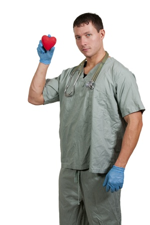 Man doctor cardiologist holding a red heart Stock Photo - 16717528