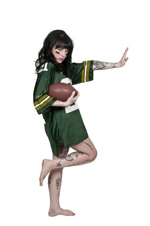 beautiful young woman playing a game of football Stock Photo - 16717681
