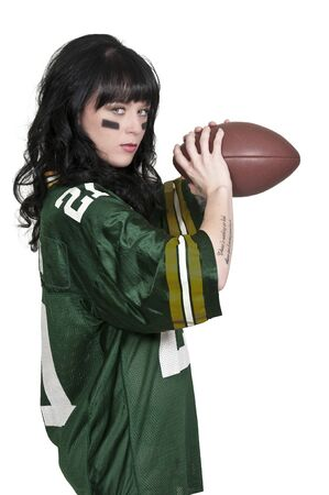 beautiful young woman playing a game of football Stock Photo - 16717610