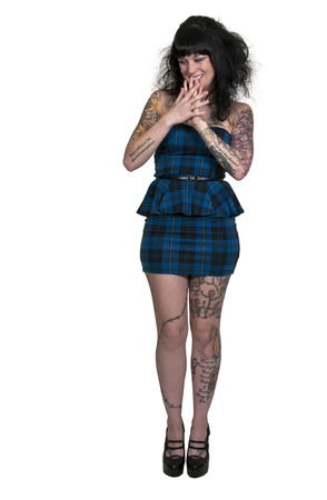 Beautiful tattooed young woman looking far away Stock Photo - 16717671