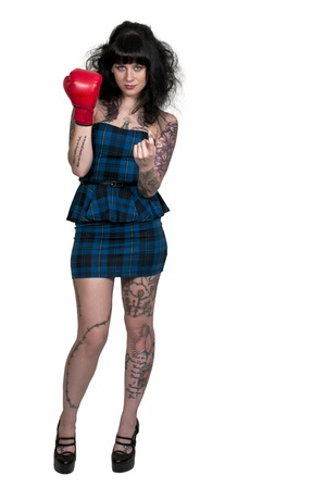 come hither: A beautiful woman in wearing a boxing glove in front of a broken heart - heartbreaker Stock Photo