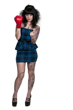 A beautiful woman in wearing a boxing glove in front of a broken heart - heartbreaker Stock Photo - 16717368