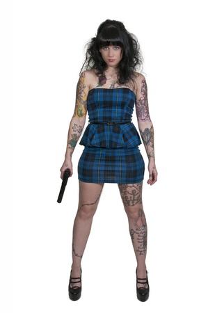 Beautiful young woman criminal with a gun Stock Photo - 16717537