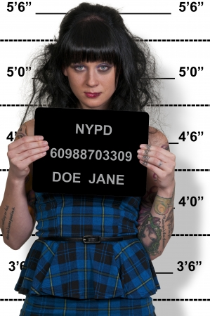 woman prison: Mugshot of a beautiful young woman criminal Stock Photo