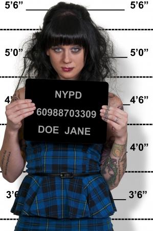 Mugshot of a beautiful young woman criminal Standard-Bild