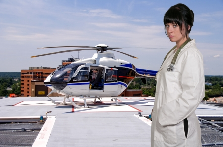 heliport: Woman doctor and a mobile flying ambulance better known as a life flight Stock Photo